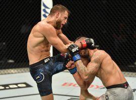 Calvin Kattar overpowered Dan Ige to win the main event on Wednesday night's UFC card from Fight Island. (Image: Jeff Bottari/Zuffa/Getty)