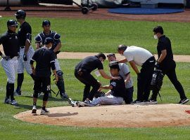 Medical staff attend to Masahiro Tanaka (ground) after struck by a batted ball by teammate, Giancarlo Stanton (far left). (Image: Adam Hunger/AP)