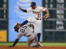 NY Yankees SS Gleyber Torres slides under 2B Houston Astros Jose Altuve. (Image: Shanna Lockwood/USA Today Sports)