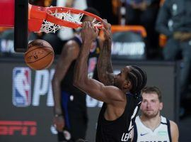 LA Clippers forward Kawhi Leonard dunks against the Dallas Mavericks in the first round of the 2020 NBA Playoffs. (Image: Ashley Landis/AP)