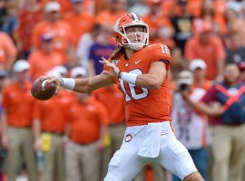 Multiple reports say that the Power 5 conferences might postpone the fall college football season, though players like Trevor Lawrence are arguing to keep the season as is. (Image: Richard Shiro/AP)