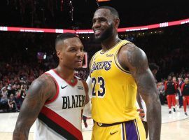 Portland Trail Blazers star Damian Lillard and LeBron James of the LA Lakers at Staples Center in 2019. (Image: Porter Lambert/Getty)