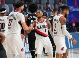 Portland Trail Blazers All-Star Damian Lillard advises a teammate against the Brooklyn Nets at Disney World of Sports in Kissimmee, Florida. (Image: AP)