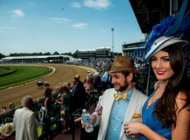 This scene of well-dressed fans soaking up the Kentucky Derby atmosphere will not happen this year. Churchill Downs officials announced the 146th Kentucky Derby will run without fans due to a coronavirus spike. (Image: Eclipse Sportswire)