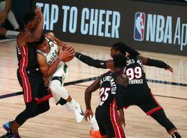 Milwaukee Bucks big man Giannis Antetokounmpo drives through Miami Heat traffic in the paint. (Image: Kim Klement/USA Today Sports)