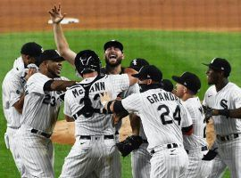 The Chicago White Sox mob pitcher Lucas Giolito after a successful no hitter bid against the Pittsburgh Pirates. (Image: Getty)