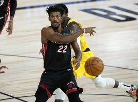 Miami Heat guard Jimmy Butler with a sleight of hand pass against the Indiana Pacers. (Image: Getty)