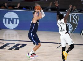 Dallas Mavericks guard Luka Doncic shoots a game-winning shot in overtime over Reggie Jackson of the LA Clippers in Game 4. (Image: Ashley Landis/AP)