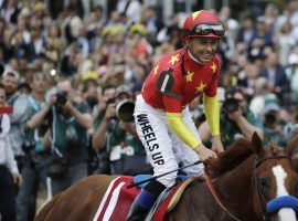 Mike Smith and his fellow jockeys aren't smiling about Churchill Downs' mandate they give up two weeks of rides to ride in the Kentucky Derby or Kentucky Oaks. (Image: Julio Cortez/Associated Press)