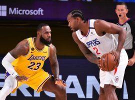 LeBron James of the LA Lakers guards Kawhi Leonard from the LA Clippers in Orlando, FL. (Image: Getty)