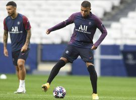 Kylian Mbappe (right) should be able to play for PSG in the club's Champions League quarterfinal match against Atalanta on Wednesday. (Image: David Ramos/AP)