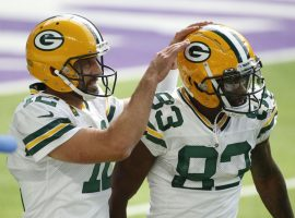 Green Bay Packers QB Aaron Rodgers congratulates WR Marquez Valdes-Scantling after a touchdown in 2019. (Image: Bruce Kluckjohn AP)