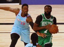 Miami Heat forward Bam Adebayo defends Boston Celtics guard Jaylen Brown. (Image: Kim Klement/USA Today Sports)