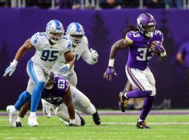 Dalvin Cook of the Minnesota Vikings scampers for a first down against the Detroit Lions in 2019. (Image: Dustin Dakota/Getty)