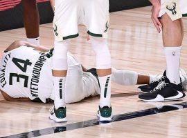 Milwaukee Bucks All-Star Giannis 'Greek Freak' Antetokounmpo on the floor after an ankle injury in Game 4 against the Miami Heat. (Image: Getty)