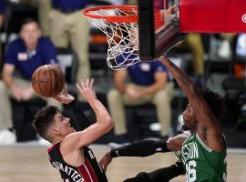 Miami Heat rookie Tyler Herro drives to the basket against Marcus Smart of the Boston Celtics in Game 4. (Image: Mark J. Terrill/AP)
