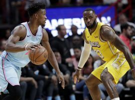 Jimmy Butler of the Miami Heat defended by LeBron James of the LA Lakers. (Image: Lynee Sladky/AP)