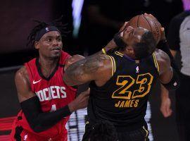 Houston Rockets swingman Daniel House, Jr. mugs LA Lakers star LeBron James in Game 1. (Image: Mark J. Terrill/AP)