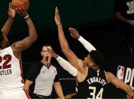 The Miami Heat's Jimmy Butler takes a shot as time expires over Giannis 'Greek Freak' Antetokounmpo of the Milwaukee Bucks in game 2. (Image: AP)