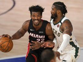 Jimmy Butler of the Miami Heat guarded by Milwaukee's Wesley Matthews in Game 1. (Image: AP)