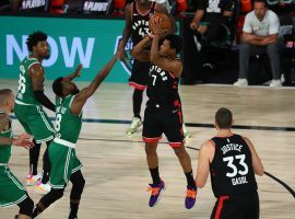 Toronto Raptors guard Kyle Lowry surrounded by the Boston Celtics in Game 6. (Image: Kim Klement/Getty)