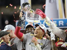 INSERT Kansas City quarterback Patrick Mahomes hoists the 2020 Super Bowl trophy. (Image: Getty)