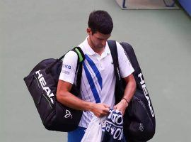 Novak Djokovic received a default in his fourth-round US Open match against Pablo Carreno Busta after accidentally striking a line judge with a ball he hit out of anger. (Image: AFP)