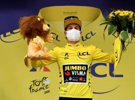 Primoz Roglic at the Stage 9 podium and wearing the leader's yellow jersey for the first time. (Image: AP)