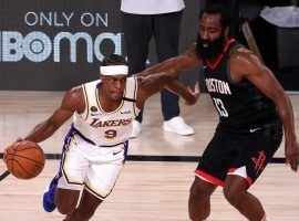 LA Lakers point guard Rajon Rondo blows by James Harden of the Houston Rockets in Game 2. (Image: Getty)