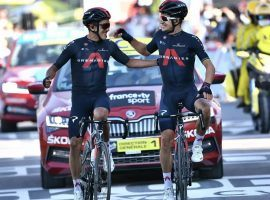 Richard Carapaz and Michal Kwiatkowski from Team Ineos celebrate at the fins line of Stage 18 of the Tour de France. (Image: Anne-Christine Poujoulat/Reuters)