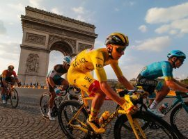 Tadej Pogacar rides into Paris with the yellow jersey as the winner of the 2020 Tour de France. (Image: Christophe Ena/AP)