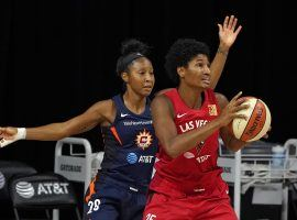 The Las Vegas Aces and Connecticut Sun will face off in a Game 5 showdown on Tuesday, with the winner going to the WNBA Finals. (Image: Chris O'Meara/AP)