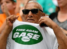 """One disgruntled New York Jets fans displays his """"Fire Adam Gase"""" t-shirt at a game in 2019. (Image: Getty)"""