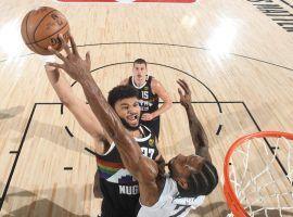 Kawhi Leonard of the LA Clippers blocks Denver guard Jamal Murray in Game 3. (Image: Getty)
