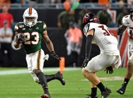 College football Week 3 features the first meeting of two ranked teams when No. 17 Miami travels to No. 18 Louisville. (Image: USA Today Sports)