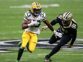 Green Bay Packers running back Aaron Jones evades a tackler on SNF. (Image: Sean Gardner/Getty)