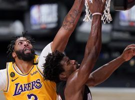 Anthony Davis of the LA Lakers attempts to block Miami Heat guard Jimmy Butler in Game 4. (Image: Mark J. Terrill/AP)