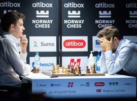 Magnus Carlsen (right) lost his first classical chess game in over two years on Saturday, as Jan-Krzysztof Duda (left) defeated him at Norway Chess. (Image: Lennart Ootes/Altibox Norway Chess)