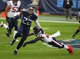 Tennessee Titans RB Derrick Henry evades tacklers against the Houston Texans. (Image: Christopher Hanewinckel/USA Today Sports)