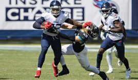 Tennessee Titans RB Derrick Henry stiffarms a Jacksonville Jaguars defender in Week 2. (Image: Getty)