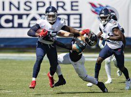 Tennessee Titans RB Derrick Henry stiffarms a Jacksonville Jaguars defender in Week 2. (Image: Getty)