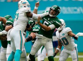 Miami Dolphins DE Emmanuel Ogbah pressures QB Joe Flacco of the New York Jets in their shutout loss. (Image: Lynn Sladky/AP)