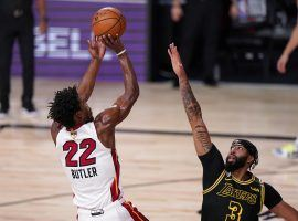 Anthony Davis of the LA Lakers guards Jimmy Butler from the Miami Heat in Game 4. (Image: Mark J. Terrill/AP)