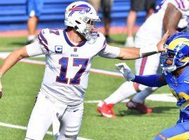 Buffalo Bills QB Josh Allen stiff arms Troy Hill of the LA Rams. (Image: Mark Konezny/USA Today Sports)