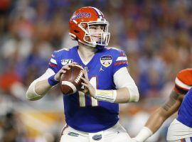 MIAMI, FLORIDA - DECEMBER 30:  Kyle Trask #11 of the Florida Gators looks to pass against the Virginia Cavaliers during the first half of the Capital One Orange Bowl at Hard Rock Stadium on December 30, 2019 in Miami, Florida. (Photo by Michael Reaves/Getty Images)