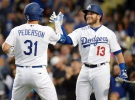 Joc Pederson and Max Muncy (#13) are part of a triple threat from the lefty side of the batter's box. (Image: Gary Vasquez/USA Today Sports)