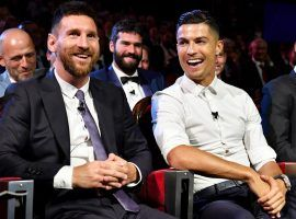 Lionel Messi (left) and Cristiano Ronaldo (center) will meet up in the group stage of the Champions League for the first time this season. (Image: Harold Cunningham/UEFA/Getty)