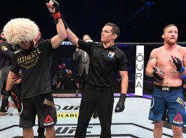 Khabib Nurmagomedov (left) announced his retirement after defeating Justin Gaethje (right) in the main event of UFC 254 on Saturday. (Image: Josh Hedges/Zuffa/Getty)