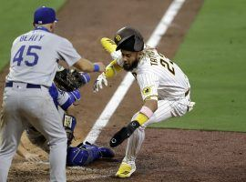 San Diego Padres star Fernando Tatis, Jr dives into home plate against the LA Dodgers. (Image: Gregory Bull/AP)