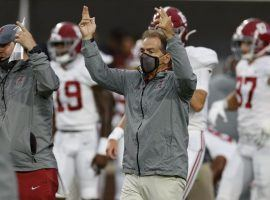 Alabama coach Nick Saban isn't going to let a positive COVID-19 diagnosis stop his team, but other to programs haven't been so lucky. (Image: Kent Gidley/USA Today Sports)